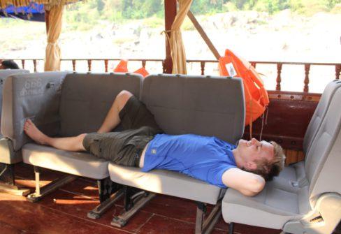 Matt Relaxing On Boat In Laos